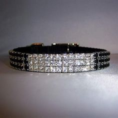 "This rhinestone ""bling"" pet collar is black nylon decorated with blocks of clear and jet black Swarovski crystals. Very unique!"