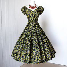 vintage 1950's dress ...fabulous JONATHAN LOGAN black and yellow rose bud novelty print full skirt pin-up party dress. $210.00, via Etsy.