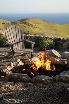 Backyard camp fire and Adirondack chair makes for a great outdoor living space. Backyard Playhouse, Backyard Camping, Backyard Games, Backyard Landscaping, Backyard Beach, Backyard Privacy, Landscaping Ideas, Outdoor Play Areas, Outdoor Fire