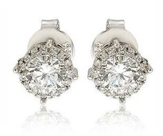 Suzy Levian Sterling Silver White Cubic Zirconia Round Stud Earrings.