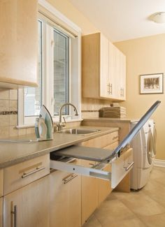 Laundry room hidden ironing board - great space saver and always at the ready...