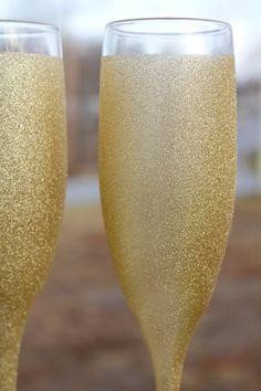 Gold Sparkly Glitter Wedding Champagne Glass or Bridal Flute. $59.00, via Etsy.