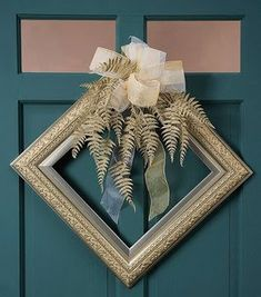 Picture Frame Wreath - Think outside the box -- create Christmas glitz and glamour with a modern twist by adding a glittered holiday fern (in shades of champagne) and a silver and gold accented picture frame. Picture Christmas Ornaments, Christmas Frames, Christmas Diy, Christmas Decorations, Xmas, Merry Christmas, Picture Frame Wreath, Picture Frame Crafts, Wreath Crafts
