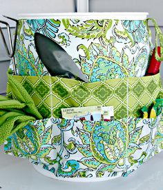Easy to make garden tote - apron like cover for 5 gallon bucket.  Good gift idea for gardening friends