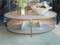 Marble and brass modern coffee or cocktail table, available at Back Home Furniture in Austin, TX for $1759.