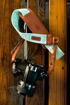 The Mint Fotostrap - a fun, pastel green colored canvas and leather camera strap from the Story Collection! All Fotostraps are made in the USA, 10% of proceeds are donated to Fotolanthropy, and offer custom monogramming to the leather shoulder pad. Add your name, initials, monogram, or even a business logo! Shop at www.fotostrap.com.