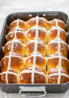 Traditional Easter Hot Crossed Buns with a cream cheese icing, brushed with a sweet syrup and filled with juicy raisins.