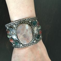 Cuff bracelet Metal and stone adjustable cuff bracelet. 2 inches at widest point. Jewelry Bracelets