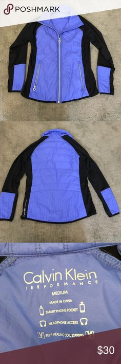 Calvin Klein zip-up jacket Blue/purple and black Calvin Klein zip-up jacket. Never been worn and in excellent condition. Very light weight and comfortable. Vest material on body and soft athletic material on arms. Perfect for any time of the year. Calvin Klein Jackets & Coats