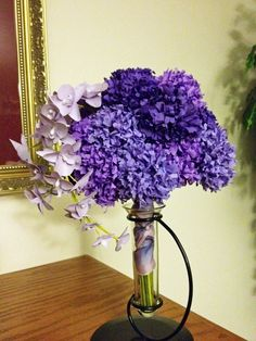 Surprise! Carnations ARE elegant and beautiful - just take a peek at this modern wedding bouquet in three shades of purple and graced with a spray of moth orchids!