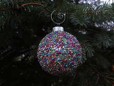 Seed Bead Ornament - could use fewer colors & match your tree design (also LOVE the spiral hook!)