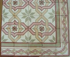Antique French Carreaux de Ciments floor tiles reclaimed from a Town House dated 1910 in Burgundy, France. The tiles are 17cm sq and 2 cm thick and tessellate to form an ornate interwoven geometric design in vieux rose, tangerine and sage on an off white background ... also very popular in Belgium ... and Malta!
