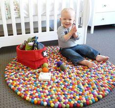 Original Larry Felt Ball Rug for carnival / circus themed nursery or toddler room.