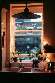 Tiny kitchen nook...with lights.  -:-:- I like adding little strands of white lights all over the house.