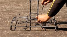 preparing rebar structure for pillar foundation, fence construction site, Champasak, Laos, footage