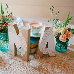 A gorgeous aqua & orange vintage wedding featuring this adorable (and super easy) DIY using wooden letters & paper doilies!