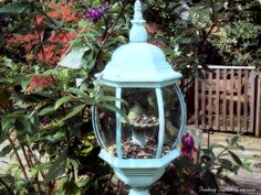 Upcycled outdoor light turned into bird feeder.. Super cute