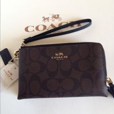 NWT Coach Double Zip Brown/Blk Wristlet NWT Coach PVC coated signature canvas, double zippered two compartments wristlet. F6431 Brown/black signature gold hardware. 2 compartments and one compartment has two slip pockets for cards. Chocolate twill lining on inside.  No Trades Coach Bags Clutches & Wristlets