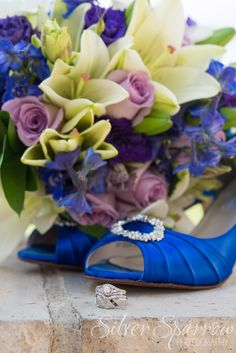 Beautiful Bridal Accessories! I LOVE the blue shoes and real flower bouquet - photo by Silver Sparrow Photography   #BlueShoes #WeddingRings #PurpleRoses #WhiteLillies #ColoradoWeddingPhotographer #DenverWeddingPhotographer #WeddingRings #WeddingDetails #WeddingInspiration