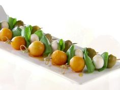 Get this all-star, easy-to-follow Melon and Olive Mini Skewers with Black Pepper Honey recipe from Giada De Laurentiis