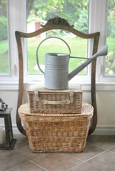 old wicker trunk & European watering can