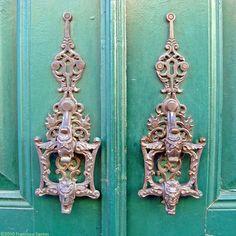 A simple pair of door knockers in Alfama, the old core of Lisbon.   The door has the date 1870.