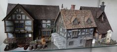 Resplendent guild houses from Stronghold Terrain. *adds to Christmas wish list*