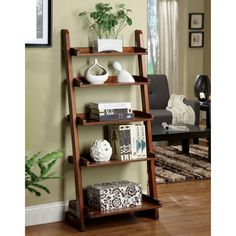This five shelf vintage oak display stand is functional and beautiful. The design, which imitates the look of a ladder, can stand by itself or lean against the wall. Make this piece your own by adding all of your cherished essentials.