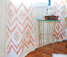 Curtains make easy and inexpensive backdrops, and can be hung up or thrown over a door | Brit + Co