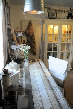 love this old farmhouse work table, love the light, flowers and cupboard too