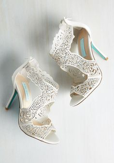 Whatever opulent occasion awaits, you know these ivory heels by Betsey Johnson will be with you during your grand entrance. Alongside an array of floral-inspired cutouts, iridescent rhinestones shine atop satin uppers, giving these stilettos a luxe look that was made for your most spectacular moments.