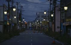 The town of Namie, once home to 20,000 people, lies inside the exclusion zone created by the Fukushima incident. The lights are left on to maintain hope that residents will eventually be allowed to return. [Japan]