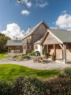 A large open plan oak eco timber frame house in Cornwall. Framed oak with clean crisp plaster to show of the feature oak trusses in this full oak frame. Timber Frame Homes, Timber Frames, Oak Frame House, Homestead House, Timber Cladding, Garage House, New Home Designs, New Builds, Open Plan