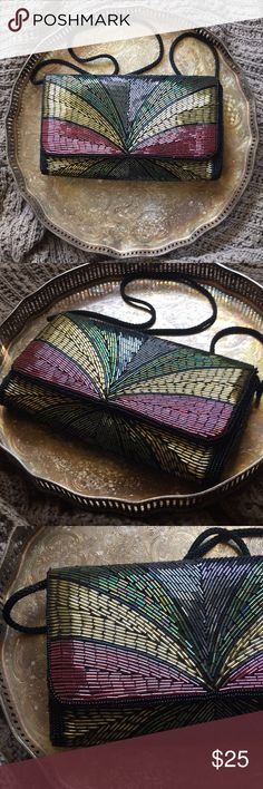 Vintage beaded clutch Vintage handmade beaded clutch. Comes with strap attached. In perfect condition. No beads missing/coming loose. Bags