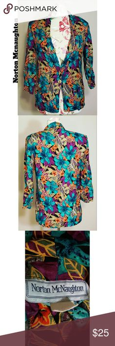 Vintage Floral Blazer A chic long sleeve blazer in black printed with flowers and leaves in fuschia, turquoise, green, and other colors. Two front pockets and padded shoulders. No major visible flaws. 1980s. Norton McNaughton Jackets & Coats Blazers