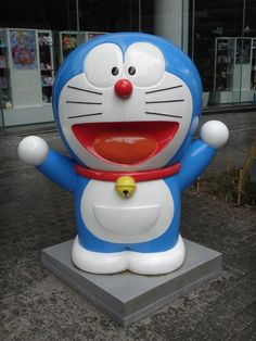 Doraemon. A robot cat is technically a cat too ;)