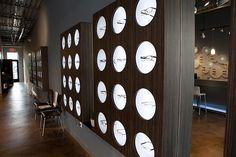 """On the shorter display wall - could we make light boxes like this with the reclaimed wood?  Metal poles above and below to """"hold it in place"""""""
