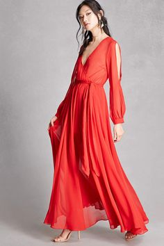 This chiffon woven maxi dress features a surplice neckline, long vented puff sleeves, a layered skirt, and an elasticized waist with a self-tie belt. This is an independent brand and not a Forever 21 branded item.