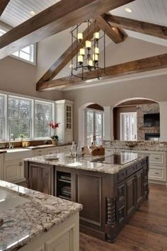 Love the counters, the dual color cabinets, farm house sink and WINDOWS,.... dreaming of a kitchen window... by Kay Berry