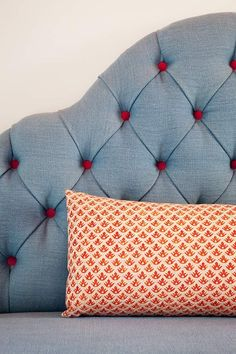 tufted headboard with different coloured buttons | palmer weiss interior design