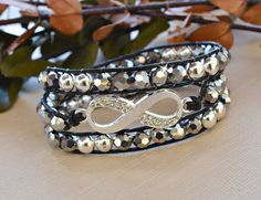 Hey, I found this really awesome Etsy listing at https://www.etsy.com/listing/203183467/black-and-silver-crystal-infinity-wrap