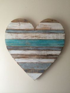 Our Beach cottage inspired heart is hand painted with teals, blue grays and…