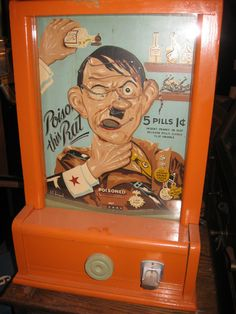 "1933 ""Poison The Rat"" arcade game - Anti-Hitler sentiment cleverly used to motivate players for this ""trade stimulator"" type machine. Pushing the rubber plunger would force the ""poison pills"" upward with the aim of putting them in Hitler's mouth."