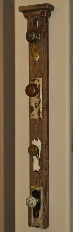 repurposed front door | ... made out of a salvaged mantle post, door knobs, and faceplates