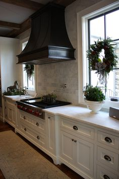 Classic with contrast of wood hood and white cabinets, love the countertops.