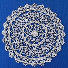 *Ravelry: Shaded Pink and Lavender Doily pattern by American Thread Company