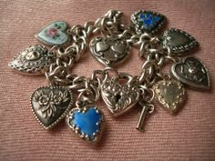 BIN for $525.00  (is higher price due to silver amt or to the Guilloche pieces & heart/subject matter, seller ??) VINTAGE STERLING SILVER HEART CHARM BRACELET LAMPL ENAMEL GUILLOCHE PADLOCK40's