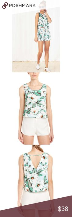 NWT Last☝️ MINKPINK 💗Getaway Tank Top Magnolia NEW still in packaging MINKPINK oversized blooms will put you in a vacation mood in this loose-cut tank boasting a V-shaped cutout at the back. Bright floral print, boatneck, 18inches from shoulder to hem. Such a fun summer top. XS=00-0, L=10 Offers considered.✨Discounted if bundled with another item. MINKPINK Tops Tank Tops