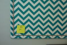 corkboard - wrap a boring old coark board in fabric, accent with upholstery tacks