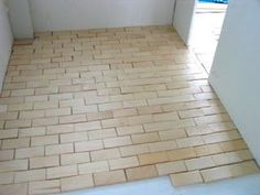 Popcycle Sticks not just for wood flooring but will use for Brick Kitchen Flooring